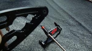 Protek shock shaft pliers to crimp spacer.